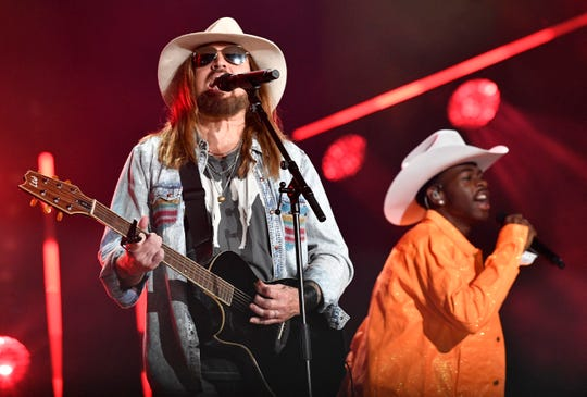 Billy Ray Cyrus performs with Lil Nas X on Saturday during the 2019 CMA Fest in Nashville.