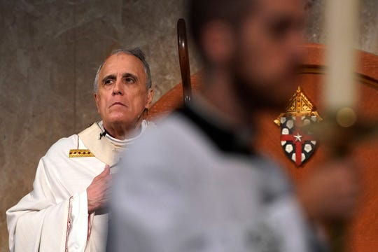 Cardinal Daniel DiNardo presides over a Mass of Ordination for seven candidates for the priesthood at the Co-Cathedral of the Sacred Heart in Houston Saturday, June 1, 2019. DiNardo, leading the U.S. Catholic Church's sex abuse response, has been accused of mishandling a case where his deputy allegedly manipulated a woman into a sexual relationship, even as he counselled her husband and solicited their donations.
