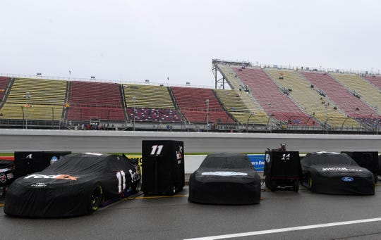 Rain mars Michigan Cup race; FireKeepers Casino 400 rescheduled for Monday