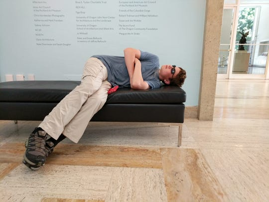 Aren Elliott at the Portland Art Museum in 2017. Museums are not for sleeping -- or are they?