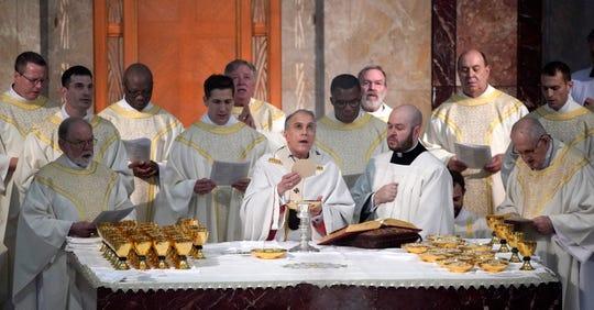 Cardinal Daniel DiNardo, center, heads the U.S. Conference of Catholic Bishops.