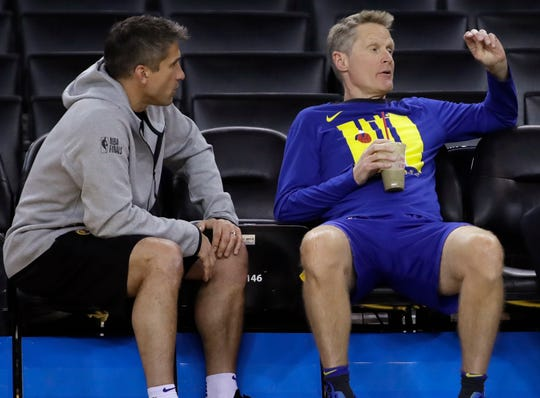 Warriors director of sports medicine and performance Rick Celebrini, left, with coach Steve Kerr.