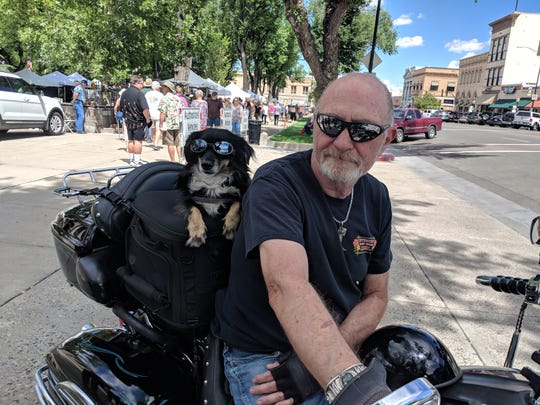 A motorcyclist and his animal friend in Prescott, Arizona, in 2018.