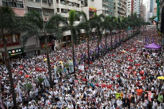 Protesters take part in a march against amendments to an extradition bill in Hong Kong, China, June 9, 2019.