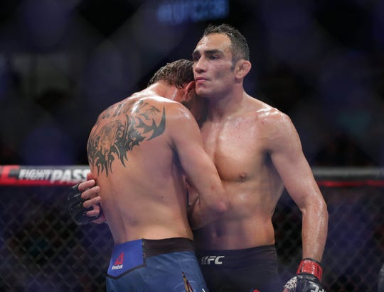 Tony Ferguson (right) and Donald Cerrone (left) embrace after their fight during UFC 238.