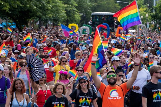 People participate in the DC Pride Parade in Washington, DC on June 8, 2019. The parade is part of DC's Capital Pride Weekend to celebrate the LGBTQ community.
