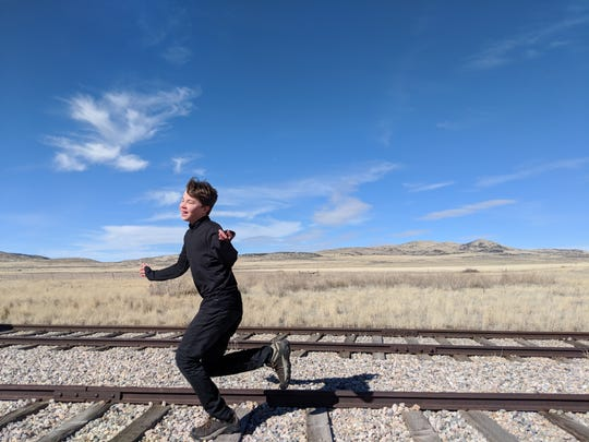 Iden runs along an abandoned track at Golden Spike National Historic Site in Utah. A posed photo? You decide.