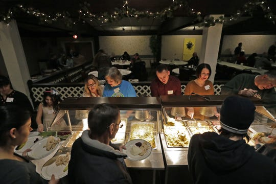 Monarch Gardens has served banquets and catered for many years. Here, a group of volunteers from Christ the Rock serve a community meal last Thanksgiving at the venue.