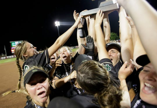 Oshkosh North players celebrate after beating Sun Prairie to win the Division 1 state championship game Saturday at Goodman Softball Complex in Madison.