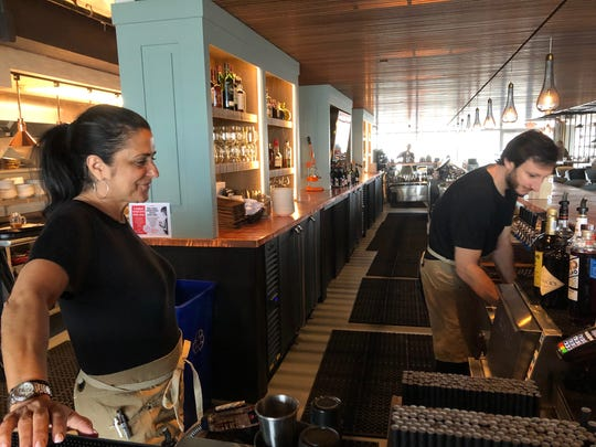 Liz Walter and Phil Sfraga, bartenders at the Iron Whale in Asbury Park, prepare for customers.