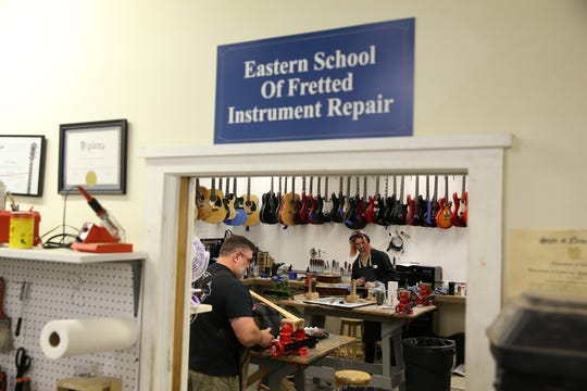 Employees of Raritan Bay Guitar Repair, a long-standing, full service fretted and stringed instrument repair facility, work on a guitars inside the Eastern School area in Freehold Twp., NJ Monday June 10, 2019.