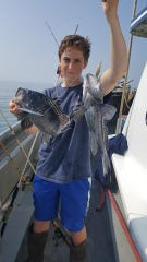 Justin Murphy, Toms River, with two sea bass he landed on the Dauntless.