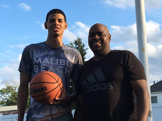 Matawan High School junior Darrell Rogers (left) with his dad Darrell Rogers Sr. on a basketball court by their home.