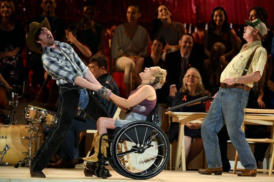 "Ridgewood native Ali Stroker, center, performs with the cast of ""Oklahoma!"" during the 73rd Tony Awards at Radio City Music Hall on Sunday, June 9, 2019, in New York."