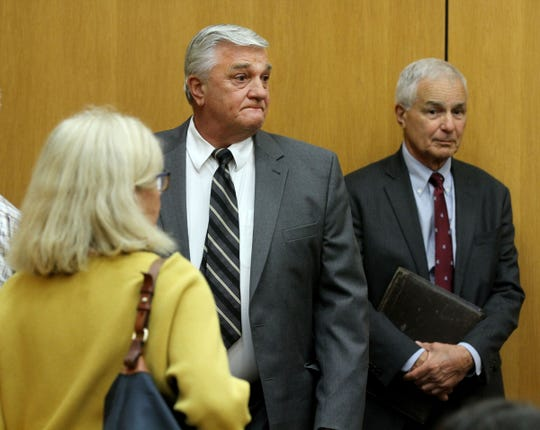 Former Brick schools superintendent Walter Uszenski (center) is shown with attorney Joseph Benedict in State Superior Court in Toms River Monday, June 10, 2019, after Judge Michael T. Collins resolved his case.