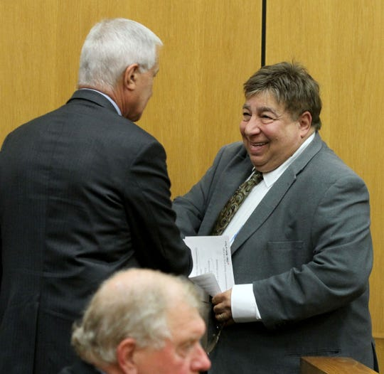Former Brick schools official Andrew Morgan smiles in State Superior Court in Toms River Monday, June 10, 2019, after Judge Michael T. Collins resolved his case.