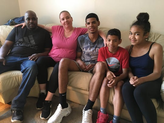 Darrell Rogers Jr. (center) surrounded by his family -- dad Darrell Sr., mom Michelle, and siblings Justin and Katrina -- in their Matawan home.