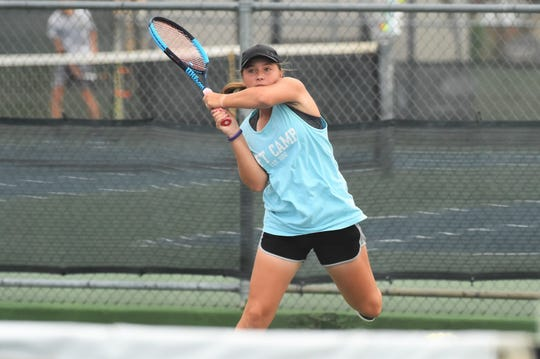 Abilene's Lauren Schaeffer follows through on a shot during her Consolation Round 3 Qualifier match at Madison Middle School on Monday. Schaeffer won the first set , but fell in three sets to Austin's Sydney Williams.