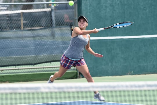Abilene's Analeah Elias follows through on a shot during the Consolation Round 3 Qualifier at Madison Middle School on Monday. Elias dropped the match 6-1, 6-2 to Sofia Kardonik of Austin.
