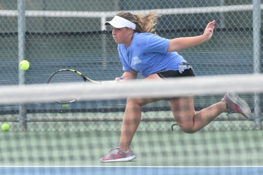 Abilene's Rachel Tebow reaches for a shot during the Consolation Round 3 Qualifier at Madison Middle School on Monday. Tebow lost the match 6-3, 6-1 to Katherine Johnston of Houston.
