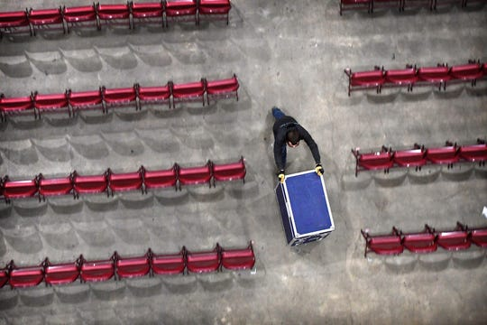 A crew sets up for a concert by Edwin McCain at the U.S. Cellular Center on April 5, 2019. Following the concert the entire set up, including the stage, was taken down and the arena prepared for a gymnastics competition.