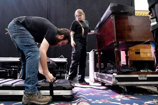 Robert Shaffer and Agnes Cheek, IATSE local 278 stage hands, prepare and arrange instruments on stage as set up for a concert by Edwin McCain at the U.S. Cellular Center on April 5, 2019.