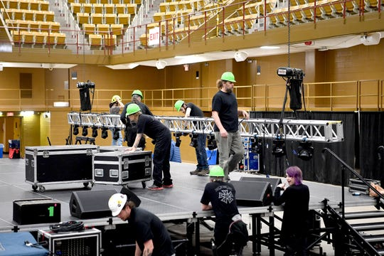 A crew sets up the lighting rig for a concert by Edwin McCain at the U.S. Cellular Center on April 5, 2019. Following the concert the entire set up, including the stage, was taken down and the arena prepared for a gymnastics competition.