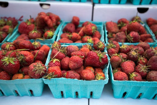 Strawberries from Mountain Top Greenhouses on sale during a previous year's Owego Strawberry Festival.
