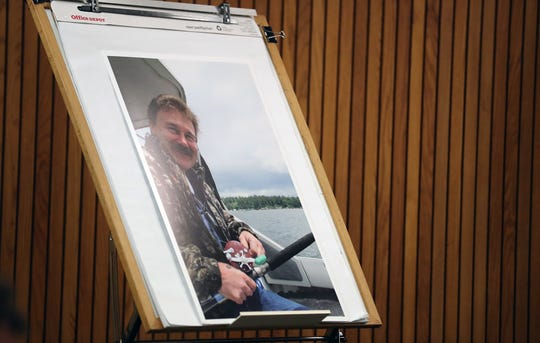 A photograph of Donald Duckworth, who was shot to death in August 2018, is displayed in the front of the courtroom during the sentencing of Brian A. Glaser in Port Orchard on Monday.