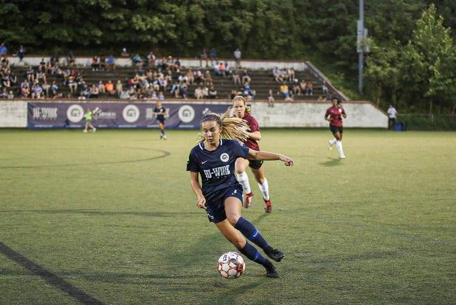 Camryn Bolick controls the ball for the Asheville City Soccer Club at Memorial Stadium in Asheville. The Owen junior has been a member of the semi-professional soccer team since its inaugural season in 2018.
