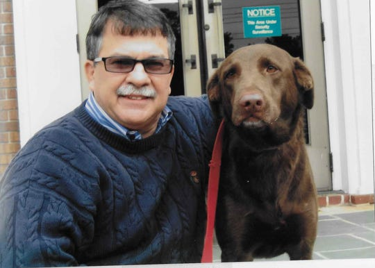 Bob Gabordi, former FLORIDA TODAY executive editor, is pictured with his family's much-loved chocolate Lab, Hazel.