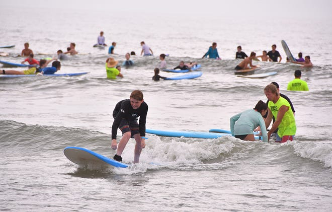 Surfers at the Club Zion Surf Camp earlier this summer.