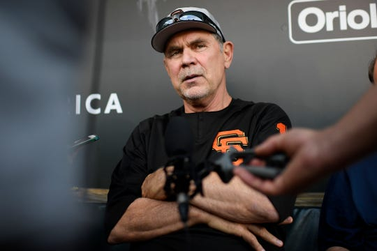 San Francisco Giants manager Bruce Bochy talks to the media in the dugout before a baseball game against the Baltimore Orioles. He recently won his 1.000th game with the Giants organization.