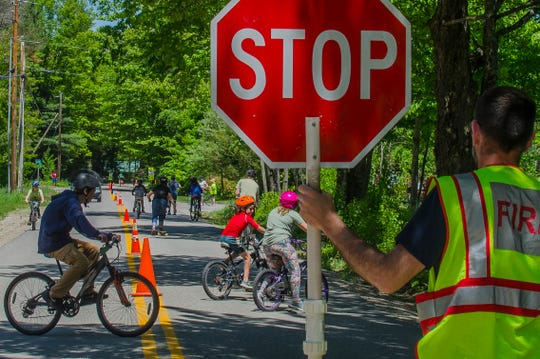 Traffic stops to make way for Ripton Elementary School student bikers at the Bike for Books on Friday, June 7.