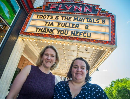 Anna Marie Gewirtz, left, the executive director of the Flynn Center for the Performing Arts, stands for a photo in front of the marquee with Madeline Bell, associate director of programs, in June 2019.