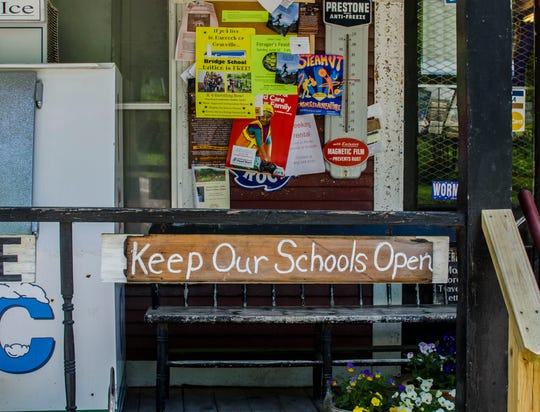 A plea to keep schools open seen on Friday, June 7 hangs at the Ripton Country Store.
