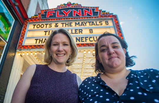 Anna Marie Gewirtz (left), the Executive Director of the Flynn Center, and Madeline Bell, the Associate Director of Programs, stand in front of the Flynn Theater in Burlington, VT. The Flynn is a recipient of a Community Thrives Local Grant from the Gannett Foundation.
