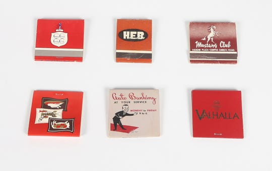 A collection of matchbooks from assorted Corpus Christi businesses. (From top, left to right) Corpus Christi Country Club, H-E-B, Mustang Club, The Torch Restaurant, The Mercantile National Bank, and Valhalla.