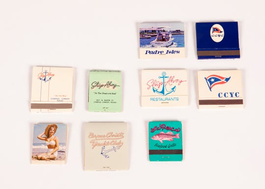 A collection of matchbooks from assorted Corpus Christi businesses. (From top, left to right) Padre Isles, Corpus Christi Yacht Club, Ship Ahoy on the Bay, Ship Ahoy, Ship Ahoy restaurants, Corpus Christi Yacht Club, Gault Aviation, Corpus Christi Yacht Club and La Pesca Seafood Grille.