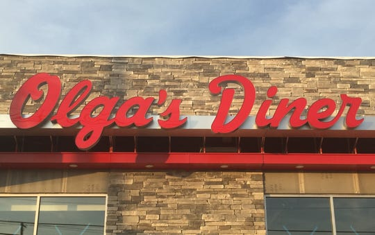 An Olga's Diner sign has appeared on a restaurant under construction on Route 73 in Evesham.