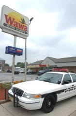 A Camden City police car sits outside a Wawa on Collings Road in the Fairview section after a July 17, 2004, shooting that killed one man and wounded three people, including a store clerk.