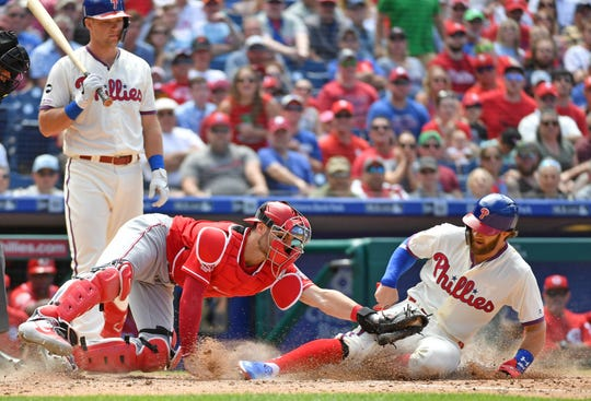 Jun 9, 2019; Philadelphia, PA, USA; Philadelphia Phillies right fielder Bryce Harper (3) is tagged out  trying to steal home by Cincinnati Reds catcher Curt Casali (12) during the fifth inning against the Cincinnati Reds at Citizens Bank Park. Mandatory Credit: Eric Hartline-USA TODAY Sports