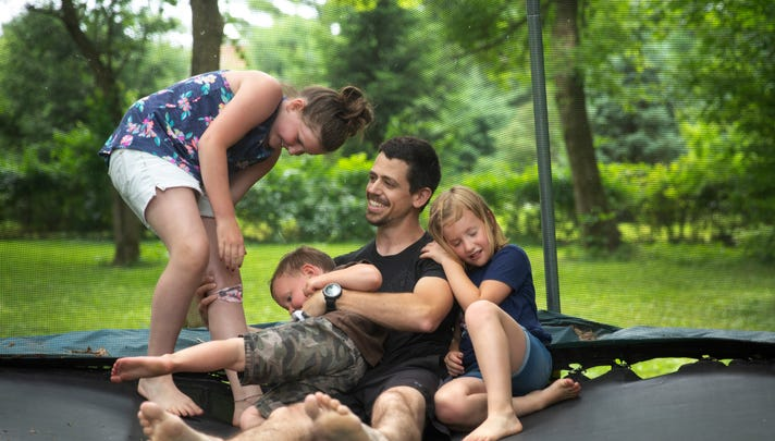 When Jake Cassinari gets home from work in the early afternoon, it's playtime with his kids, LillyMae, 10, Ever, 4, and Zoe, 6. Jake married their mom, Liz, last August on the grounds of their new home in Springboro. Liz's first husband, Jordan Pieniazek, a Cincinnati firefighter, was killed May 1, 2016. Jake and Liz are committed to preserving Jordan's memory for the children.