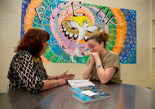 Scarlet Hudson, pastor with Women of Alabaster, talks about scripture with Ashley Pels, 33. Like most women battling addiction, Pels had abuse and trauma in her life starting at young age. Hudson was visiting the women in the recovery pod at the jail.