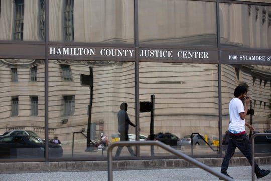 The Hamilton County Courthouse is reflected in the window of the Justice Center in Downtown Cincinnati. Most of arraignments happen in the Justice Center. It was built in 1985 at a cost of $54 million, according to the jail's website. It's overseen by the sheriff's department.
