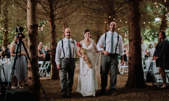 Liz is walked down the aisle by her former father-in-law, Slim Pieniazek, left, and former brother-in-law, Luke Pieniazek. Liz married Jake Cassinari on the grounds of their new home in Springboro September 4, 2018. The former tree farm created a perfect aisle. Family, friends and children, LillyMae, 10, Zoe, 6 and Ever, 4, helped celebrate the happy union. Liz's first husband, Jordan Pieniazek, a Cincinnati firefighter, was killed May 1, 2016. As Jake celebrates his first Father's Day, he and Liz are committed to preserving Jordan's memory for the children.