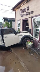 This Mini Cooper collided with another car and then crashed into Chino's Auto Sales on Fort Campbell Boulevard Sunday, June 9, 2019.