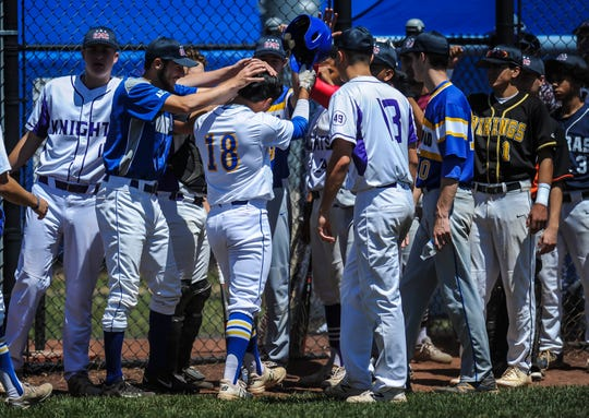Andrew Tan (18) of North Brunswick is greeted by teammates upon his return to the dugout following his three-run home run in the 29th annual Frank Gavigan Senior All-Star baseball game at Community Park in North Brunswick on June 9, 2019.