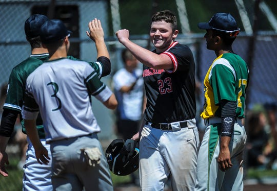 Sam Duffy (23) of Woodbridge receives high fives from teammates upon his return to the dugout following his two-run home run in the 29th annual Frank Gavigan Senior All-Star baseball game at Community Park in North Brunswick on June 9, 2019.