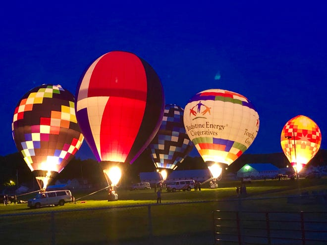 Night Glow, a popular attraction during the Coshocton Hot Air Balloon Festival, draws spectators from far and wide. The event is one of those canceled this year due to the coronavirus.